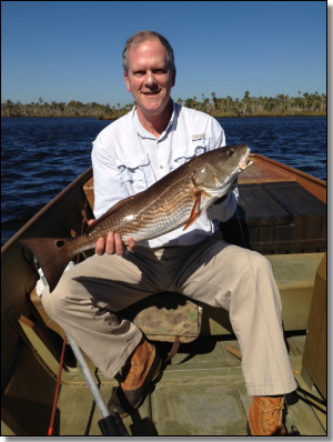 Ed Ellett, and... gofc_feature_2013_111.png ...Charles Allen fishing the back-creeks of Suwannee on a windy November weekend.